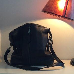 Black urban purse/backpack.